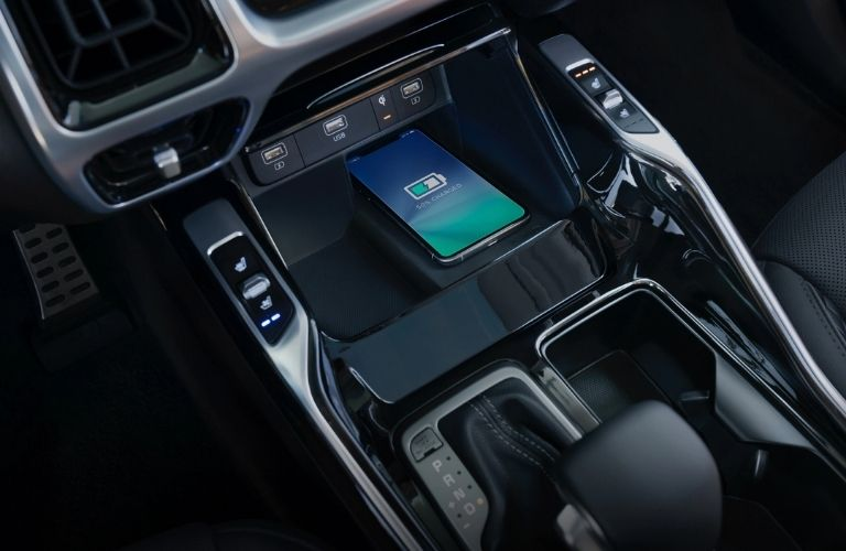 Interior view of the wireless smartphone charger available inside a 2021 Kia Sorento