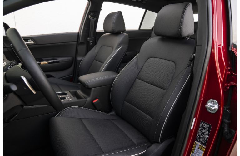 Interior view of the front seating area inside a 2021 Kia Sportage