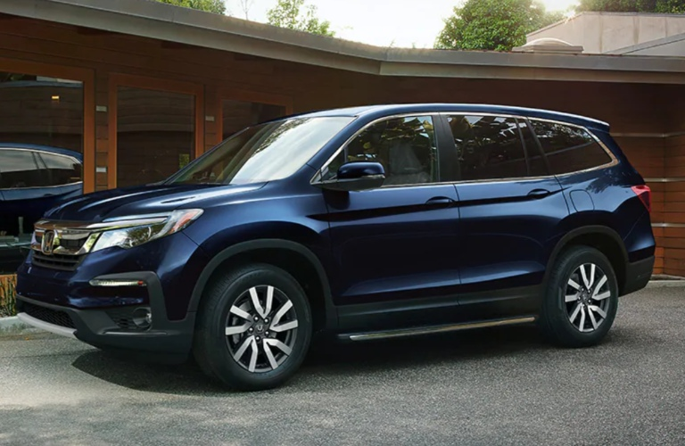 2020 Honda Pilot parked in front of a building