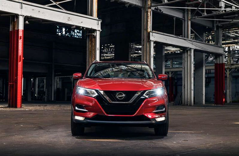2020 Nissan Rogue Sport parked in front of a large building
