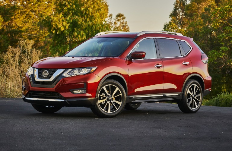 2020 Nissan Rogue with green and yellow trees