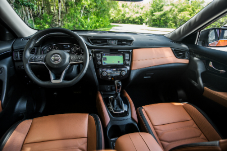 Front Interior Of 2018 Nissan Rogue Including Steering Wheel And Infotainment System For Instance