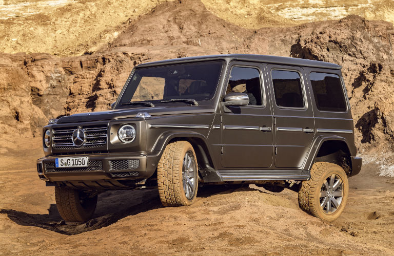 2019 G-Class driving off-road over rocky terrain