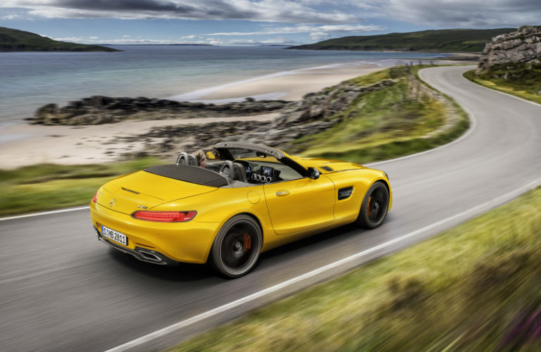 2019 GT S Roadster in yellow driving by the ocean