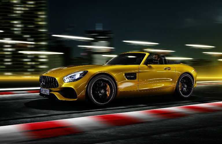 2019 GT S Roadster in yellow driving with the top up at night