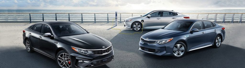 Three 2020 Kia Optima models parked in a pier