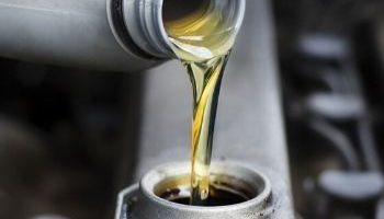 Engine oil being poured into vehicle