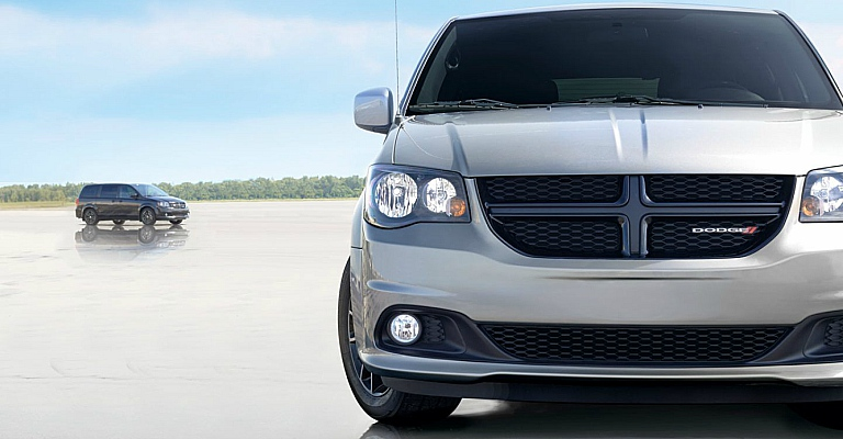 2018 Dodge Grand Caravan fron view with the side view of another in the distance