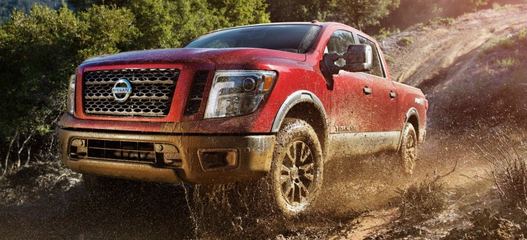 2018 Nissan Titan red front view in mud