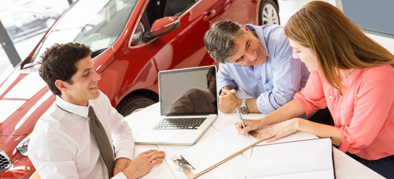 Customers reviewing a vehicle history report
