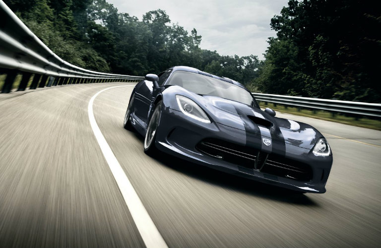 black-and-gray-Dodge-Viper-driving-along-curve