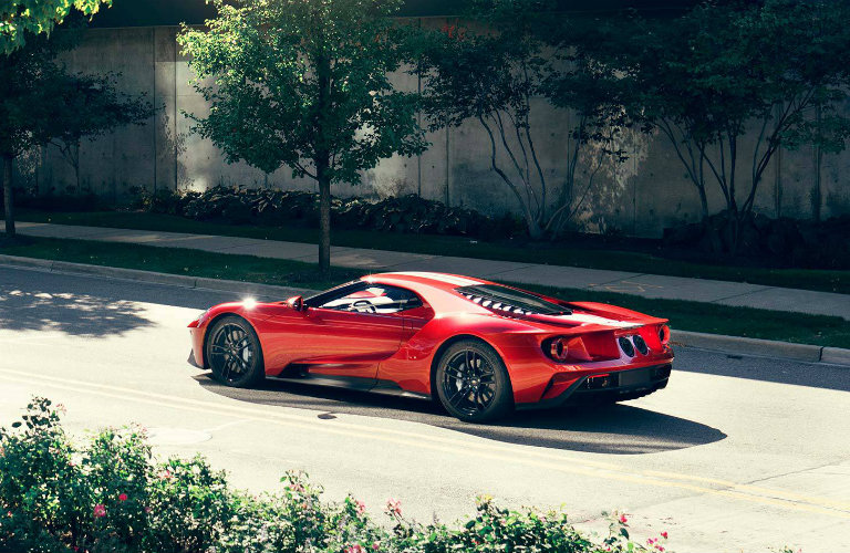 red-Ford-GT-driving-on-residential-street