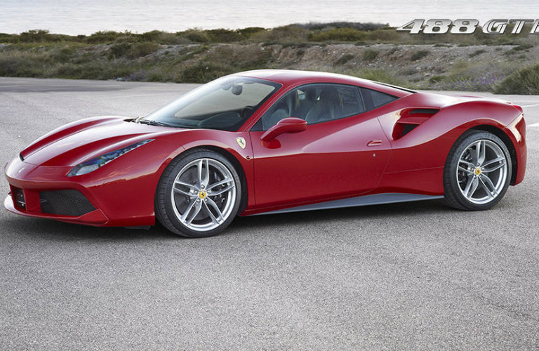 side-profile-of-red-Ferrari-488-GTB-parked-on-pavement