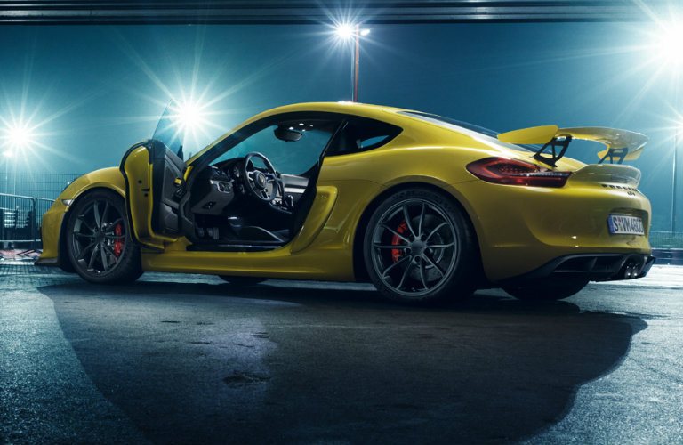 yellow-Porsche-Cayman-GT4-parked-at-night-with-doors-open