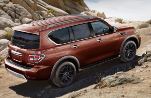 2018 Nissan Armada driving up a rocky path