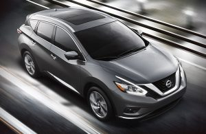 2018 Nissan Murano driving in black, white and gray setting