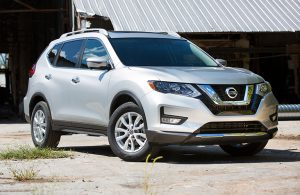 2018 Nissan Rogue parked outside a building