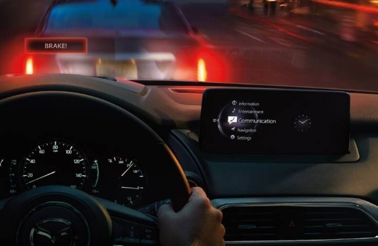 The steering wheel and navigation system of the 2021 Mazda CX-9