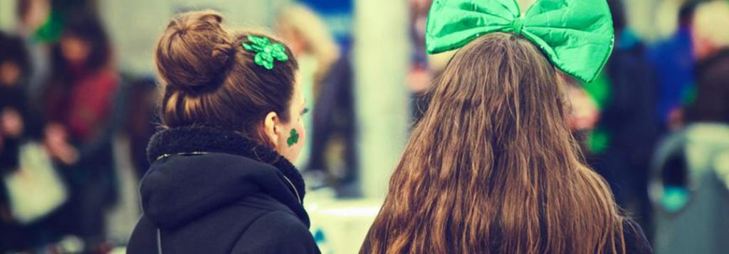 Two girls wearing green bows on St. Patrick's Day