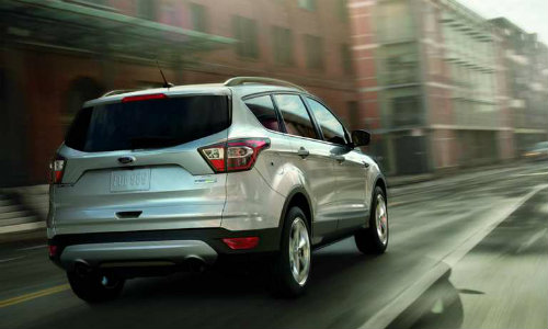 2018 Ford Escape driving down wet road on overcast day