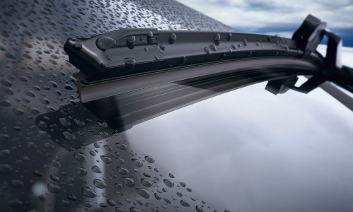 Isolated view of windshield wipers working on vehicle