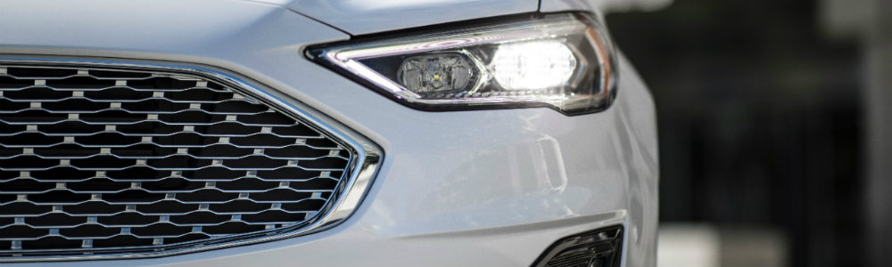 Isolated view of 2019 Ford Fusion mesh grille and front headlight