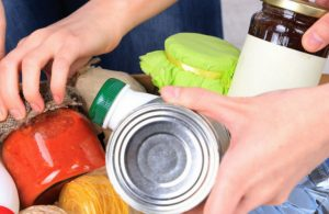 Close Up of Hands Grabbing Food Donations