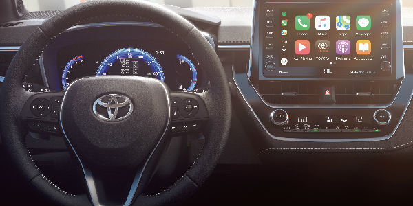 Interior View of Touchscreen and Steering Wheel in the 2019 Toyota Corolla Hatchback