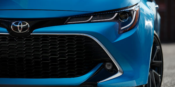 2019 Toyota Corolla Hatchback View of Grille and Exterior in Blue Coloring