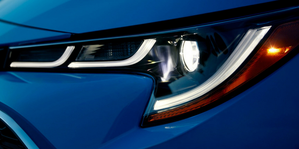 2019 Toyota Corolla Hatchback Close-up View of Headlight with Blue Flame Exterior