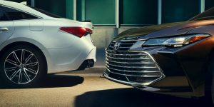 2019 Toyota Avalon Front View of Black Exterior and Rear View of White Exterior
