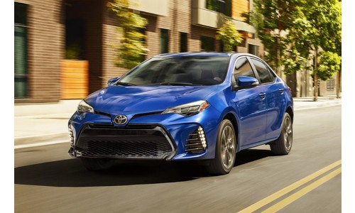 2019 Toyota Corolla blue driving down city streets
