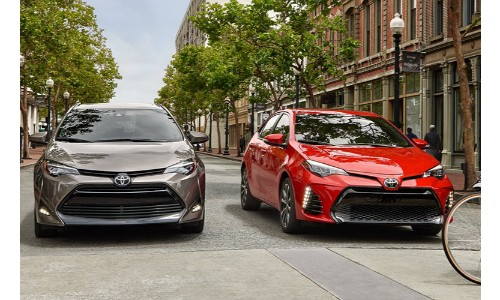 2 2019 Toyota Corolla side by side gray and red