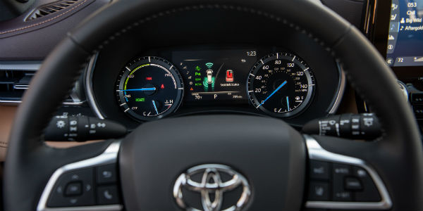 Closeup of steering wheel and dashboard in 2020 Toyota Highlander