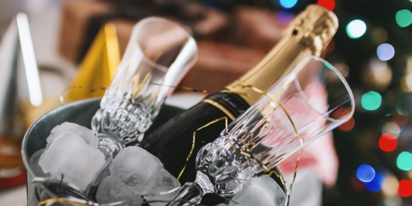 Champagne bottles and glasses in bucket