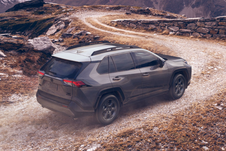 A photo of the 2020 Toyota RAV4 driving on a gravel road.
