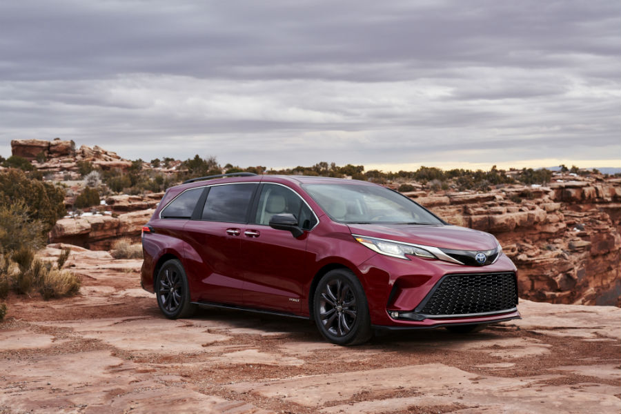 A front right quarter photo of the 2021 Toyota Sienna parked in the desert.