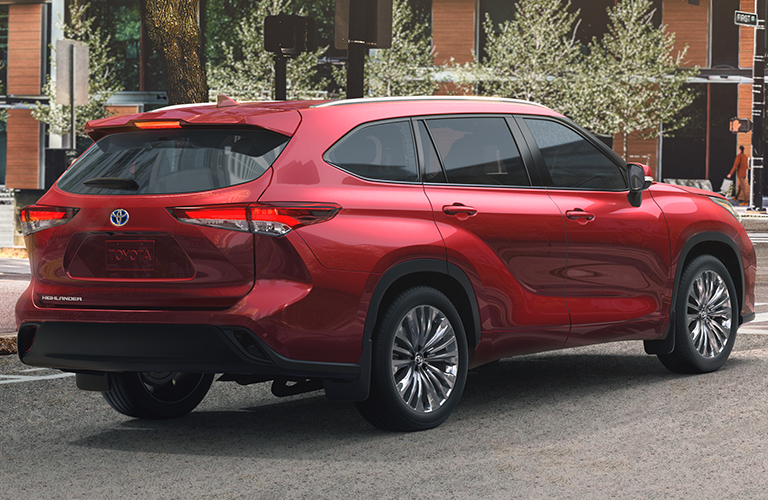 Passenger's side rear angle view of red 2020 Toyota Highlander Hybrid