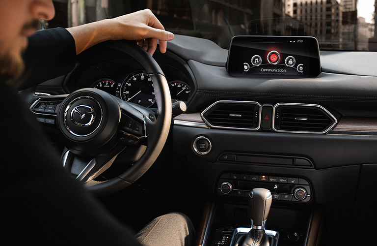 person behind the wheel of a 2020 Mazda CX-5