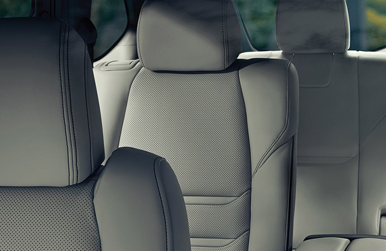 An interior image of the second and third-row seating inside of a 2020 Mazda CX-9.